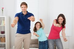 Happy family playing videogame Royalty Free Stock Photo