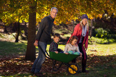 Happy family playing with the wheelbarrow Royalty Free Stock Images