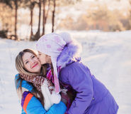 Happy family playing in winter Royalty Free Stock Image