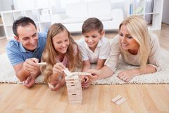 Happy Family Playing With The Wooden Blocks royalty free stock image