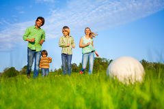 Happy family plays football in summer Royalty Free Stock Image