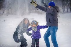 Family plays snowballs royalty free stock images