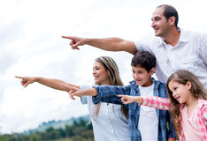 Happy family pointing away Stock Photography