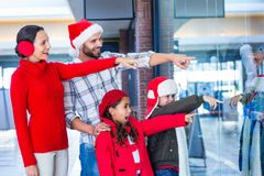 Happy family pointing at something Royalty Free Stock Photo