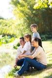 Happy family pond Stock Photos