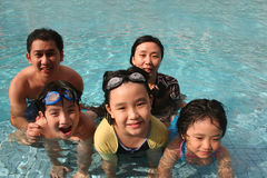 Happy family in the pool. One happy family playing in the pool Stock Images