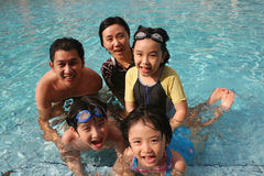 Happy family in the pool. One happy family playing in the pool Royalty Free Stock Image