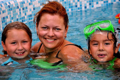 Happy family in the pool. Happy family in a swimming pool having fun Royalty Free Stock Photos