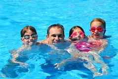 Happy family pool. Happy family in a swimming pool Stock Images