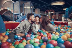 Happy family in pool with balls Royalty Free Stock Photos
