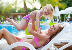 Happy family in the pool, having fun. Mother with baby, summer holidays, vacation concept Stock Image
