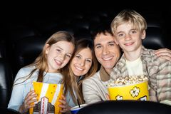 Happy Family With Popcorn At Cinema Theater Royalty Free Stock Photo