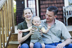 Happy family on porch Stock Image