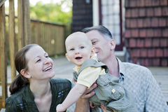 Happy family on porch Royalty Free Stock Image