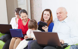 Happy family of with portable computers Royalty Free Stock Image
