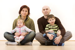 Happy family portrait. A portrait of a young, happy family royalty free stock photos