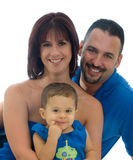 Happy family portrait. Charming family portrait of mother, father and baby boy all relaxed and smiling on a white background Stock Image