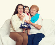 Happy family portrait - baby, woman and old lady on white Royalty Free Stock Image