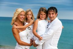 Happy family portrait on beach. Stock Image