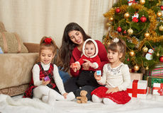 Happy family portrait in christmas decoration, winter holiday concept, decorated fir tree and gifts Stock Photos