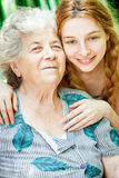 Happy family portrait - daughter and grandmother. Outdoor stock images