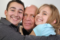 Family portrait of elderly father with children Stock Photos
