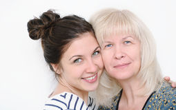 Happy family portrait of embracing smiling mother and daughter o Royalty Free Stock Images