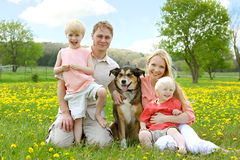 Happy Family Portrait in Flower Meadow Stock Photo