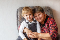 Happy family portrait with grandmother and little grandson. Royalty Free Stock Image