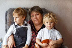 Happy family portrait with grandmother and two grandsons. Stock Photos