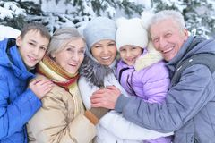 Happy family portrait. Smiling and posing outdoors in winter Royalty Free Stock Photo