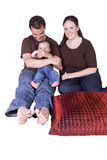 Happy Family Portrait with Mother, Father and Son Stock Photo