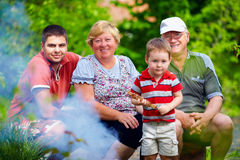 Happy family portrait on picnic, colorful outdoors Stock Images