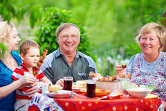 Happy family portrait on picnic, colorful outdoors Royalty Free Stock Photography