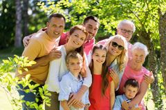Happy family portrait in summer garden royalty free stock photography