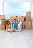 Happy family portrait in their new home Royalty Free Stock Images