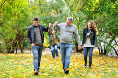 Happy family portrait walking together Stock Images