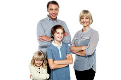 Happy family posing with arms crossed Royalty Free Stock Photos