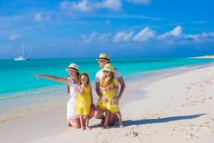 Happy family posing at beach during tropical Stock Images