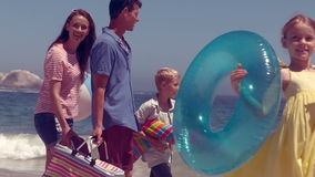 Happy family posing with buoys. On the beach stock video footage