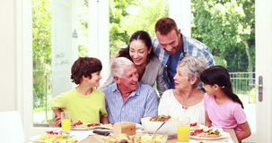 Happy family posing during lunch stock footage