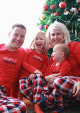 Happy family posing next to the Christmas tree Royalty Free Stock Images