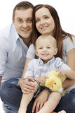 Happy family posing together on white background. royalty free stock image