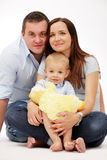 Happy family posing on white background. stock images