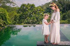 Happy family, pregnant mom and daughter resting in hotel, Bali royalty free stock photo
