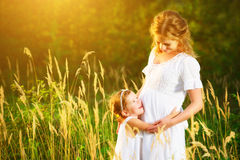 Happy family,  pregnant mother and daughter little child in summ Stock Photography