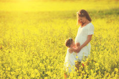 Happy family,  pregnant mother and daughter little child in summ Royalty Free Stock Photos