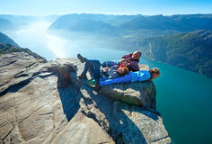 Happy family on  Preikestolen massive cliff top (Norway) Stock Photo