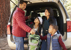 Happy family prepare for a hike at the back of their car Royalty Free Stock Images