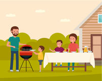 Happy family preparing a barbecue grill outdoors. Family leisure. Stock Photos